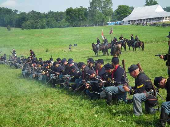 "150th Gettysburg Reenactment 2013 (9178579675)"" by S Pakhrin from DC, USA Licensed under CC BY 2.0 via Wikimedia Commons"